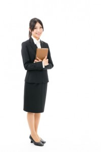 asian businesswoman standing on white background