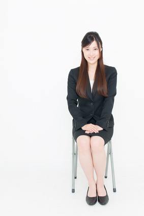 young asian businesswoman sitting