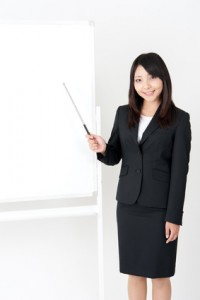 asian businesswoman with whiteboard